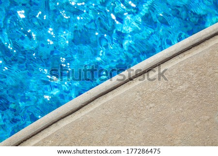 blue water and stone edge pool abstract background - stock photo