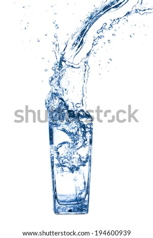 blue water being poured in a  glass . - stock photo
