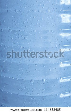 blue water bubbles in plastic bottle texture background - stock photo