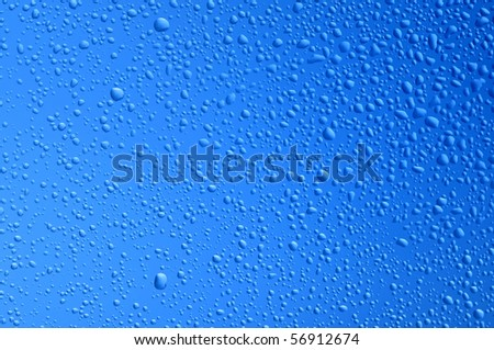 blue water bubbles on the window for background - stock photo