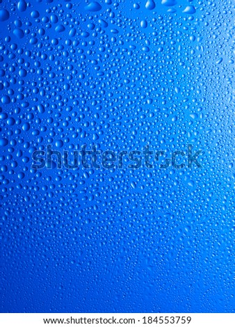 Blue water drops background, wet window - stock photo