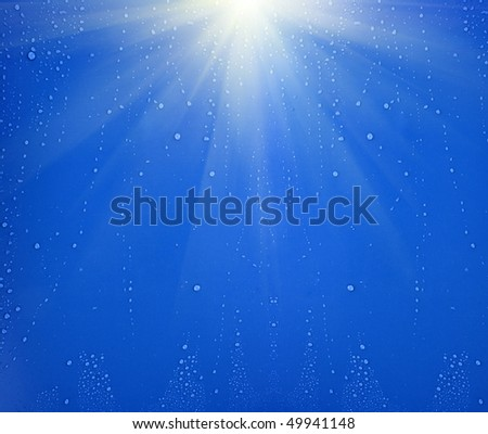 Blue water drops background with big and small drops - stock photo