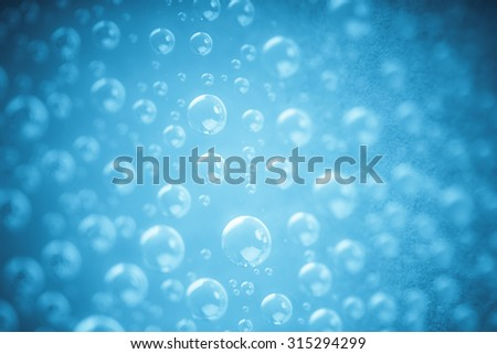 Blue water drops of on surface treat water-repellent in macro lens shot small-DOF - stock photo