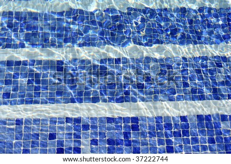 blue water in swimming pool, background - stock photo