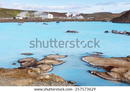 Blue water lake created by the  station of geothermal production at Blue Lagoon, near Reykjavik, Iceland - stock photo