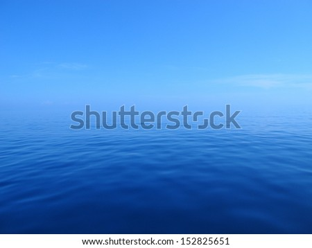 Blue Water Meets Blue Sky - stock photo