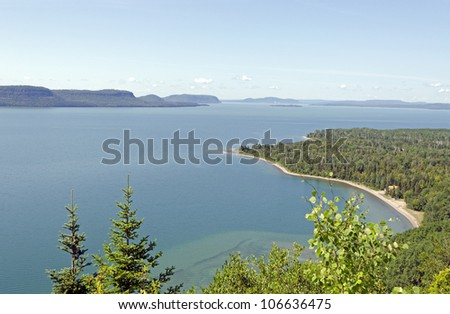 blue water of Superior Lake, Ontario under blue sky.