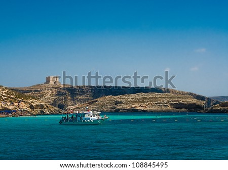 Blue water of the Blue Lagoon in Comino, Malta - stock photo