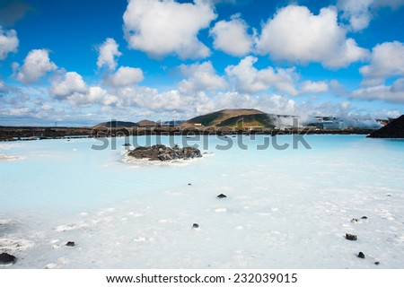 Blue water of the famous Icelandic Blue Lagoon spa is produced by near geothermal plant. The spa is located on Reykjanes peninsula not far from Keflavik airport and Reykjavik capital, Iceland.  - stock photo