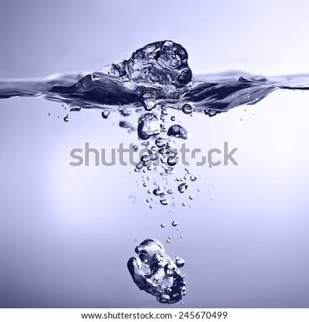 blue Water splash. - stock photo