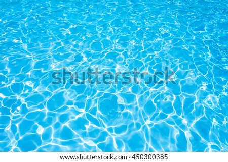 Blue water surface with sun reflection in swimming pool - stock photo