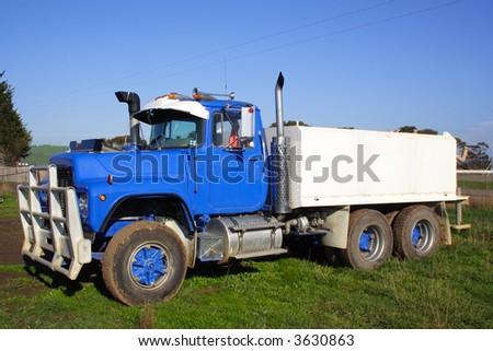 Blue water truck - stock photo