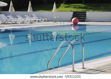 blue water with reflection at hotel resort swimming pool outdoor at sunny day - stock photo