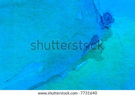Blue watercolor on green paper abstract background - stock photo