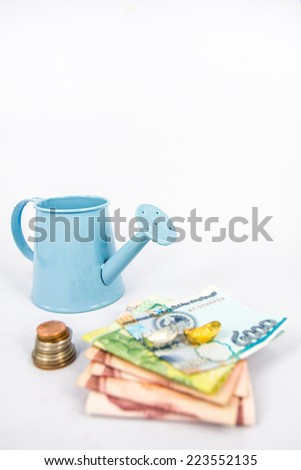 blue watering can with money   (path in side) isolate on white ,Interpretive to money investment , glow up money - stock photo
