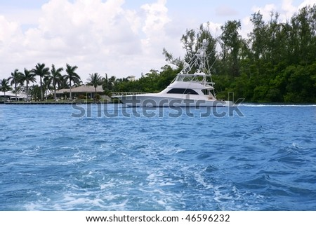 Blue waterway in Florida with fishing boat Pompano Beach - stock photo