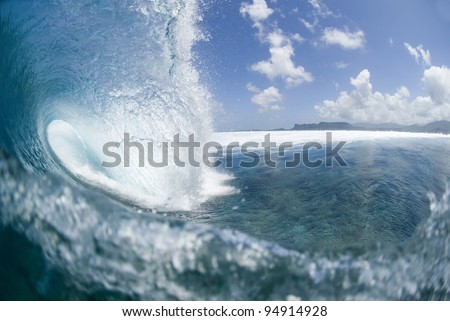 blue wave breaking on coral reef at Pohnpei in the Pacific Ocean - stock photo