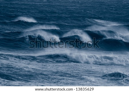 Blue waves on a stormy day at the sea - stock photo