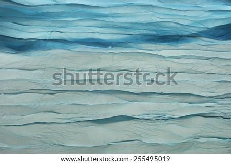 Blue Wavy Aquamarine Fabric Texture Background Close-up - stock photo