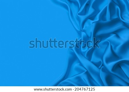 Blue wavy Silk background texture - stock photo