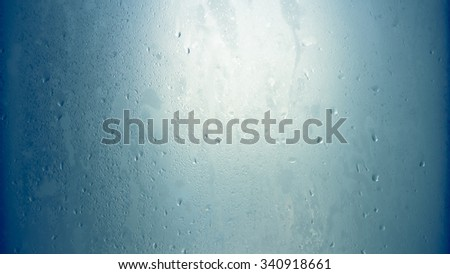 Blue wet glass ambient background. - stock photo