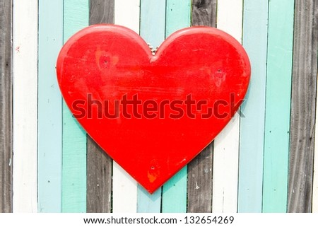 Blue, white, black contrasting old wooden texture background with heart shape, taken on a sunny day - stock photo