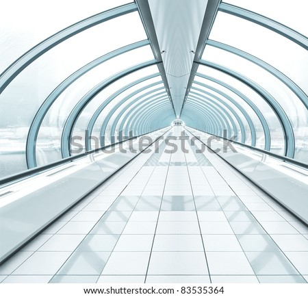 blue wide spacious corridor in contemporary airport walkway - stock photo