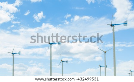 Blue wind turbines with blue sky