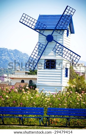 Blue windmill with blue chair