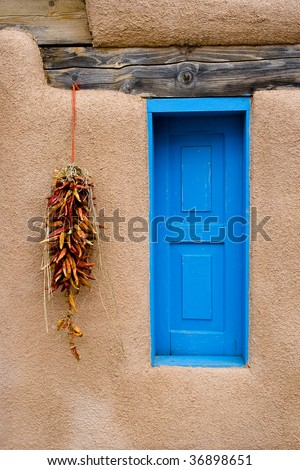 Blue window and Red Pepper Ristra - stock photo