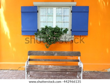Blue Window Floors, walls, orange, yellow Chairs are placed - stock photo