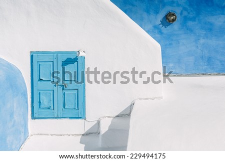Blue window in Oia, Thira island - known as Santorini - Greece. - stock photo
