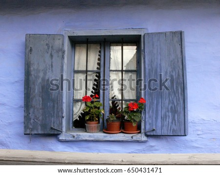 Blue window on a blue house in a Hungarian village in Transylvania, Romania