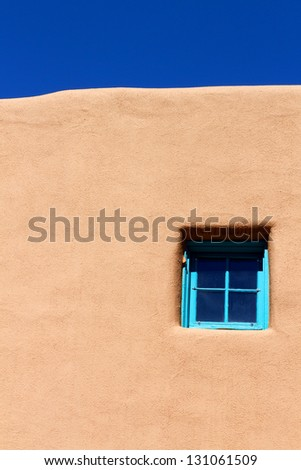 Blue Window on Adobe Wall - stock photo