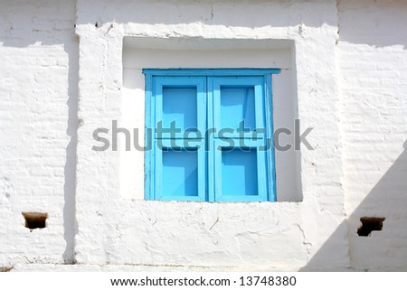 Blue window (window blinds on traditional Mediterranean house)