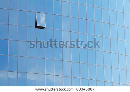 Blue windows of modern building - stock photo