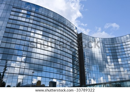 Blue windows of office building - stock photo