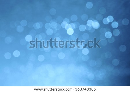 blue winter background with soft lens flares circles - stock photo