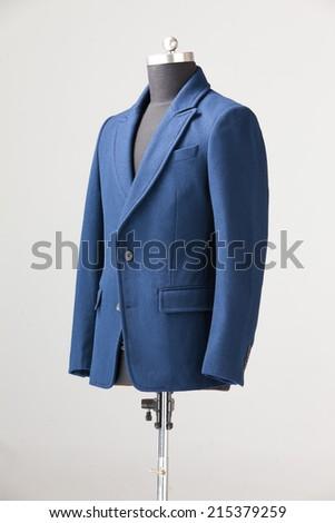 blue winter coat isolated on gray background - stock photo