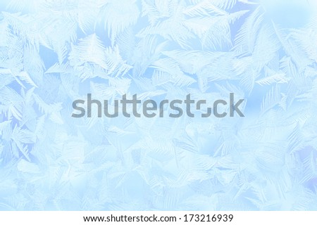 blue winter ice ornament on the glass - stock photo