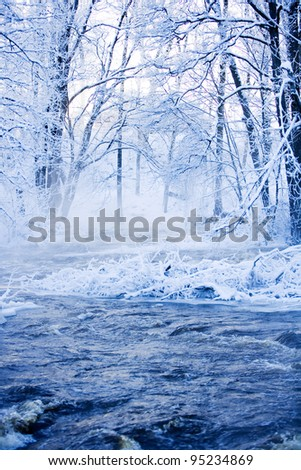 Blue Winter landscape with water - stock photo