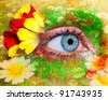 blue woman eye makeup inspired in spring with flowers meadow and yellow petals [photo-illustration] - stock photo