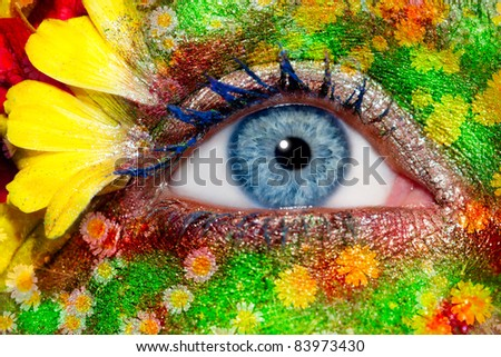 blue woman eye makeup inspired in spring with flowers meadow and yellow petals [ photo-illustration ]