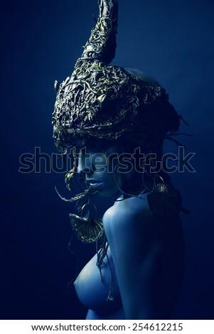 Blue woman in original head wear - stock photo