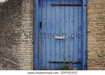 blue wood door and cotswolds stone