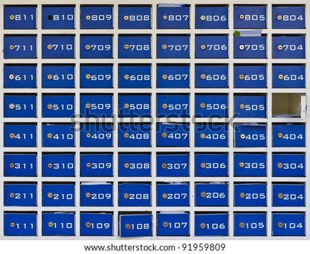 blue wood mail boxes - stock photo