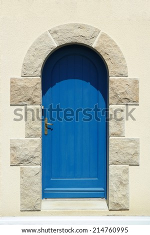 Blue wooden arch door in C�´tes-d'Armor, France - stock photo