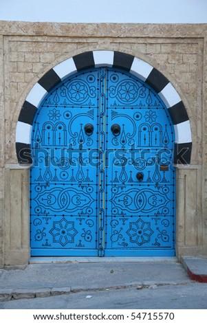 blue wooden door in arabic style - stock photo