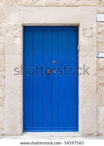Blue wooden frontdoor. - stock photo