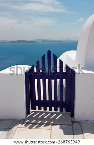 blue wooden gates against volcano caldera, beautiful details of Santorini island, Greece - stock photo